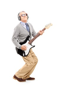 Mature Man Rocking Out with Guitar