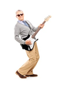 Mature Man Rocking Out with Guitar.