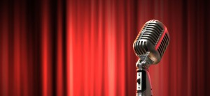 Old-Microphone-on-Red-Background-facing-left