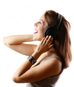 Girl singing with headphones.