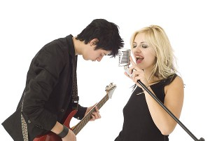 Guy playing Guitar and Female Singer.