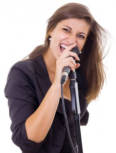 Woman-Singing-Into-Microphone-600px